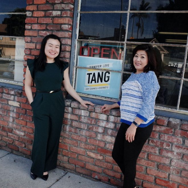 Jennifer Love Tang and her campaign sign